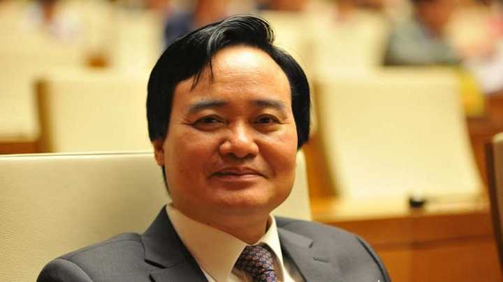 Hinh anh 'Mon no' khien Bo truong Phung Xuan Nha cam thay day dut khi chua tra duoc.