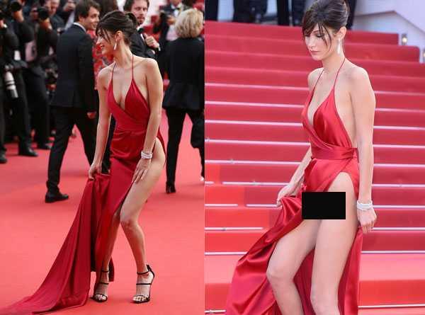 Dù tự tin nhưng người đẹp vẫn có những giây phút lúng túng giữ váy để tránh gặp sự cố. Trong một khoảnh khắc, cô cũng bị lộ quần nịt màu đỏ bên trong.