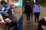 Hai nữ sinh đánh nhau, bạn cùng trường đứng quanh reo hò cổ vũ