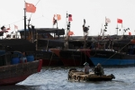 Trung Quốc cấp súng ống cho đội tàu cá trên biển Đông