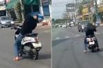 Choáng với clip vừa lái xe máy vừa ngoẹo cổ ngủ gật trên đường