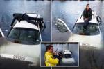 Bỏ mặc bạn mắc kẹt trong xe, tài xế say xỉn ngồi tán gẫu trên nóc xe đang chìm
