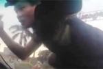 Đã bắt kẻ nhảy lên nóc ô tô đang chạy, nghi dàn cảnh cướp