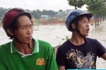 2 thợ hồ cứu sống một phụ nữ bị nước cuốn trôi