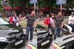 Tài xế xe Camry đi sai, lấn làn còn xuống dọa nạt tài xế taxi
