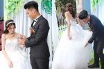 Mạc Hồng Quân ân cần chỉnh sửa váy cưới cho cô dâu Kỳ Hân trong bữa tiệc