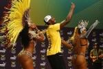 Ảnh Olympic ngày 2: Usain Bolt nhảy samba, VĐV cử tạ Thái Lan giành HCV