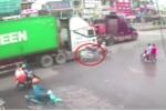 Camera ghi lại hình ảnh 'thần chết ngủ quên' khi người đàn ông bị xe container va phải