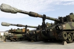the-united-states-m109a6-paladin-is-one-of-natos-nearest-equivalent-weapons-with-a-155mm-cannon-similar-to-the-koalitsiya-sv-it-requires-a-six-man-crew-to-operate-the-machine
