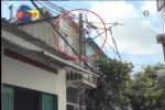 TP.HCM: Cột điện nằm cách cửa nhà 5 cm, dân thấp thỏm sợ cháy nổ