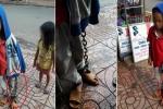 Video: Bé trai bị xích chân tay lang thang giữa chợ cùng em ruột gây phẫn nộ