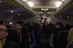 Hành khách cởi trần đấm bốc trên máy bay