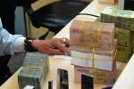 Ngân hàng giảm lãi suất cho vay, lãi suất huy động 'thủng' trần