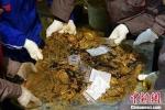 Phát hiện gần 500 miếng vàng ròng trong lăng mộ cổ ở Trung Quốc