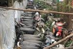 Xe vi phạm để ngổn ngang, phủ bụi trong sân trụ sở CSGT