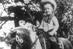 former-us-president-bill-clinton-on-a-pony-near-his-childhood-home-in-arkansas
