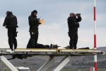 3A64A97000000578-3937566-Greek_and_U_S_security_officials_stand_guard_before_the_arrival_-a-30_1479247706575
