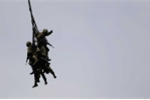 over-in-japan-members-of-the-ground-self-defense-forces-practice-holding-onto-a-rope-dangling-from-a-cargo-helicopter