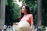 Hồ Quỳnh Hương diện áo dài, đội nón lá khoe sắc ở Nhật Bản