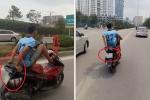 Ngang nhiên lái xe máy bằng chân, đi vào làn buýt nhanh khiến người đi đường kinh hãi