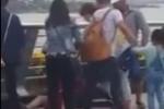 Đôi nam nữ bị đánh hội đồng trên cầu vượt, người đi qua quay clip và mặc kệ