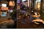 Những hình ảnh 'độc' trong cơn mưa như trút nước ở Hà Nội