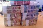 Đổi tiền lẻ Tết Nguyên đán: Ngân hàng thiếu, chợ đen 'hét giá'