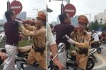 Video: Đi vào làn BRT, người trên ô tô hung hăng đánh tài xế xe máy