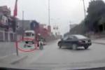 Ngã ra đường sau va chạm, 2 vợ chồng bị xe container tông chết