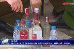 Clip: 'Đột kích' lò rượu giả sắp bung hàng Tết ở Hà Nội