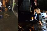 Mưa lớn kéo dài, người Hà Nội khốn khổ ăn tối giữa biển nước