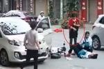 Mở cửa ô tô hất văng 2 học sinh, 'quý bà' thản nhiên nhìn nạn nhân nằm giữa đường