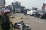Va chạm với xe máy đi cùng chiều, cô gái bị xe tải cán chết