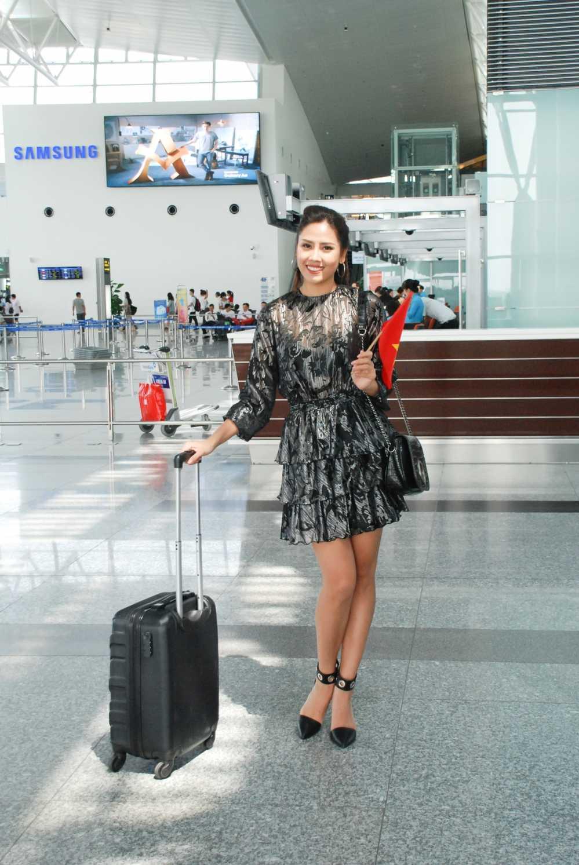 Nguyen Thi Loan rang ro len duong tham du Hoa hau Hoa binh Quoc te 2016 hinh anh 1