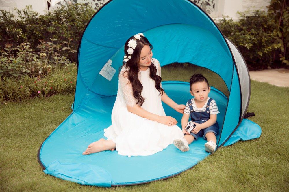 Vy Oanh hanh phuc ben con trai trong thang cuoi cua thai ki hinh anh 1