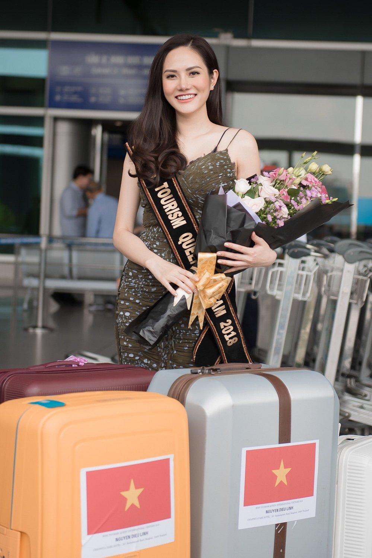 Dieu Linh mang hon 30 bo trang phuc du thi 'Nu hoang Du lich Quoc te 2018' hinh anh 1