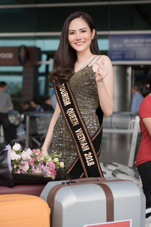 Dieu Linh mang hon 30 bo trang phuc du thi 'Nu hoang Du lich Quoc te 2018' hinh anh 2