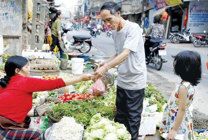 Tang thue VAT 12%: 'Bo Tai chinh noi khong anh huong nguoi ngheo la vong vo, lap lo' hinh anh 1
