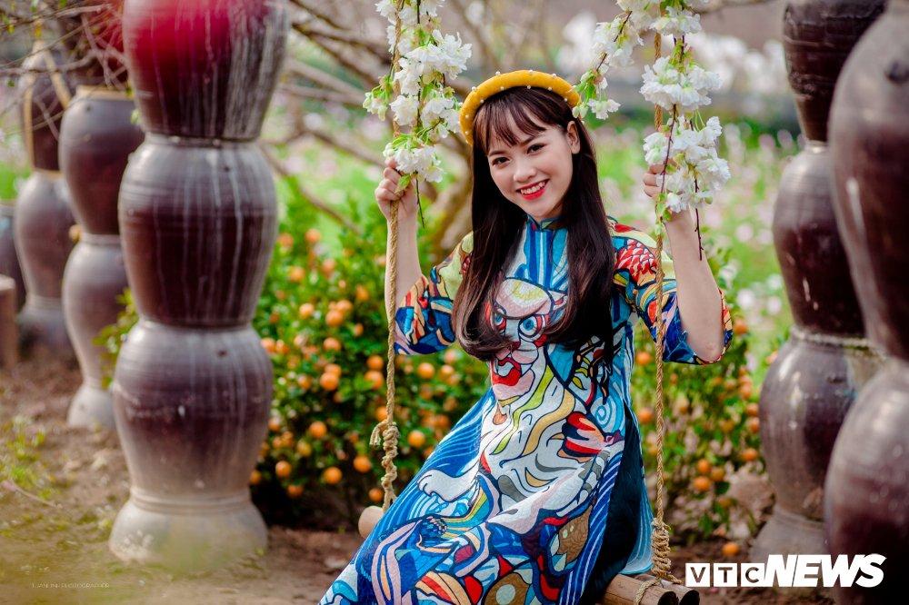 'Hot girl rang khenh' xu Tuyen rang ro trong bo anh don Xuan hinh anh 4
