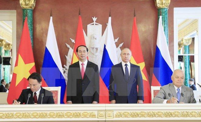 Chu tich nuoc Tran Dai Quang hoi dam voi Tong thong Nga Putin hinh anh 1