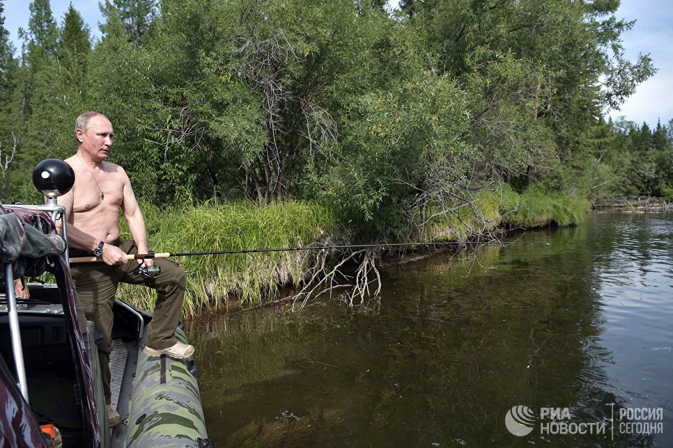 Anh: Tong thong Putin minh tran san ca o Siberia hinh anh 9