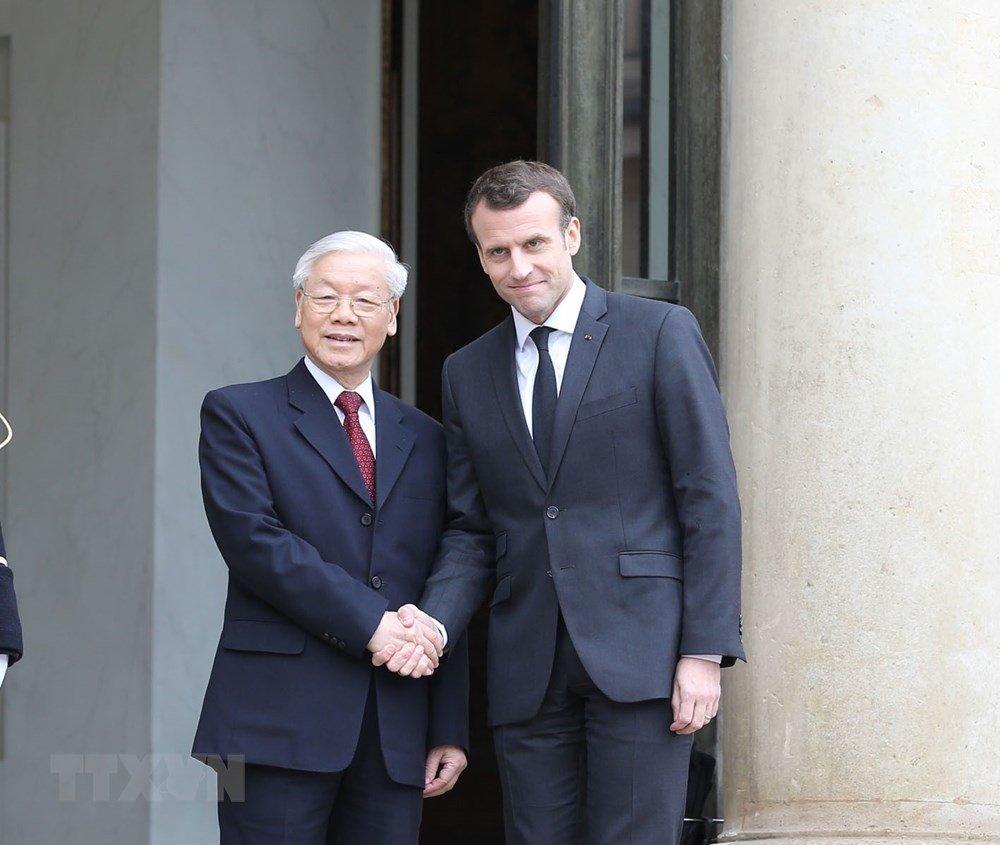 Tong Bi thu Nguyen Phu Trong hoi dam voi Tong thong Emmanuel Macron hinh anh 1