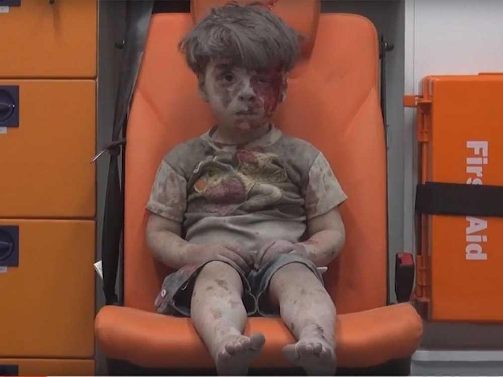 Truyen thong Trung Quoc nghi ngo doan video cau be Syria la san pham dan dung hinh anh 1
