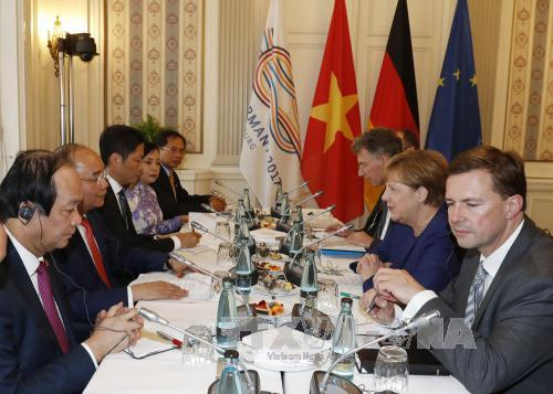 Thu tuong Nguyen Xuan Phuc hoi dam voi Thu tuong Duc Angela Merkel hinh anh 2