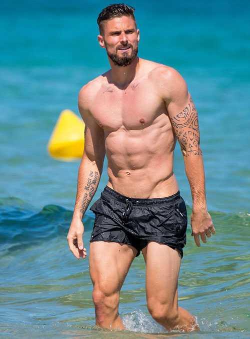 Giroud khoe co báp, bạn gái xinh dep mac bikini lọ bụng to hinh anh 6