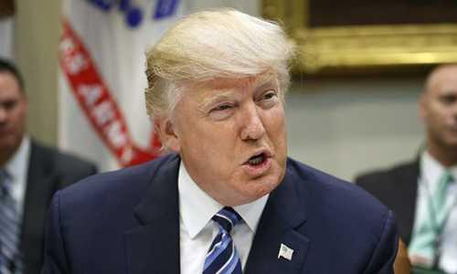 Tong thong Trump tuyen bo he thong luat phap My 'da hong' hinh anh 1