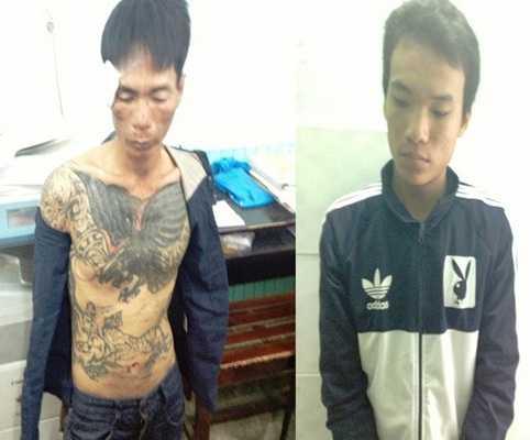 Trần Minh Sang (trái) và Lê Thanh Tùng (phải) tại cơ quan công an