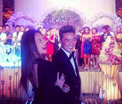 Đàm Vĩnh Hưng và Mỹ Tâm đi dự đám cưới (ảnh: Mốt & Cuộc sống)