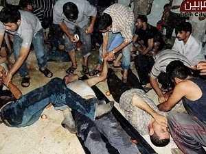 Hình ảnh truyền hình do phe đối lập tung ra với cáo buộc quân đội Syria đã sử dụng vũ khí hóa học dạng khí để tấn công phe nổi dậy - Nguồn: AP