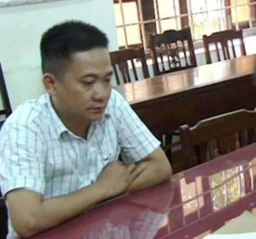 Đối tượng Nguyễn Xuân Đức tại cơ quan công an. (Ảnh LĐ).